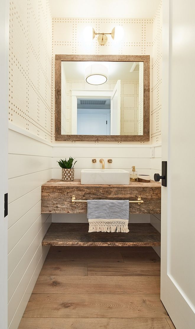 Farmhouse Style Bathroom Features Half Wall Shiplap Wainscoting With Wallpaper Above Wide Plank Hardwood Flooring Reclaimed Wood Mirror