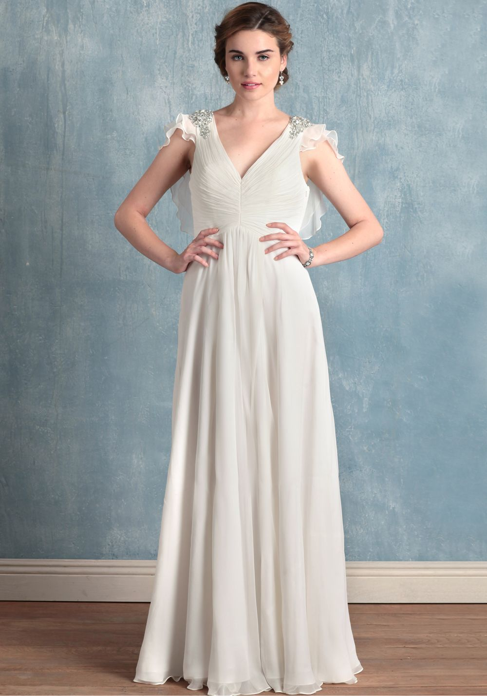 Beach wedding dress under 500  Delicately ruched white silk georgette radiates outward from a light
