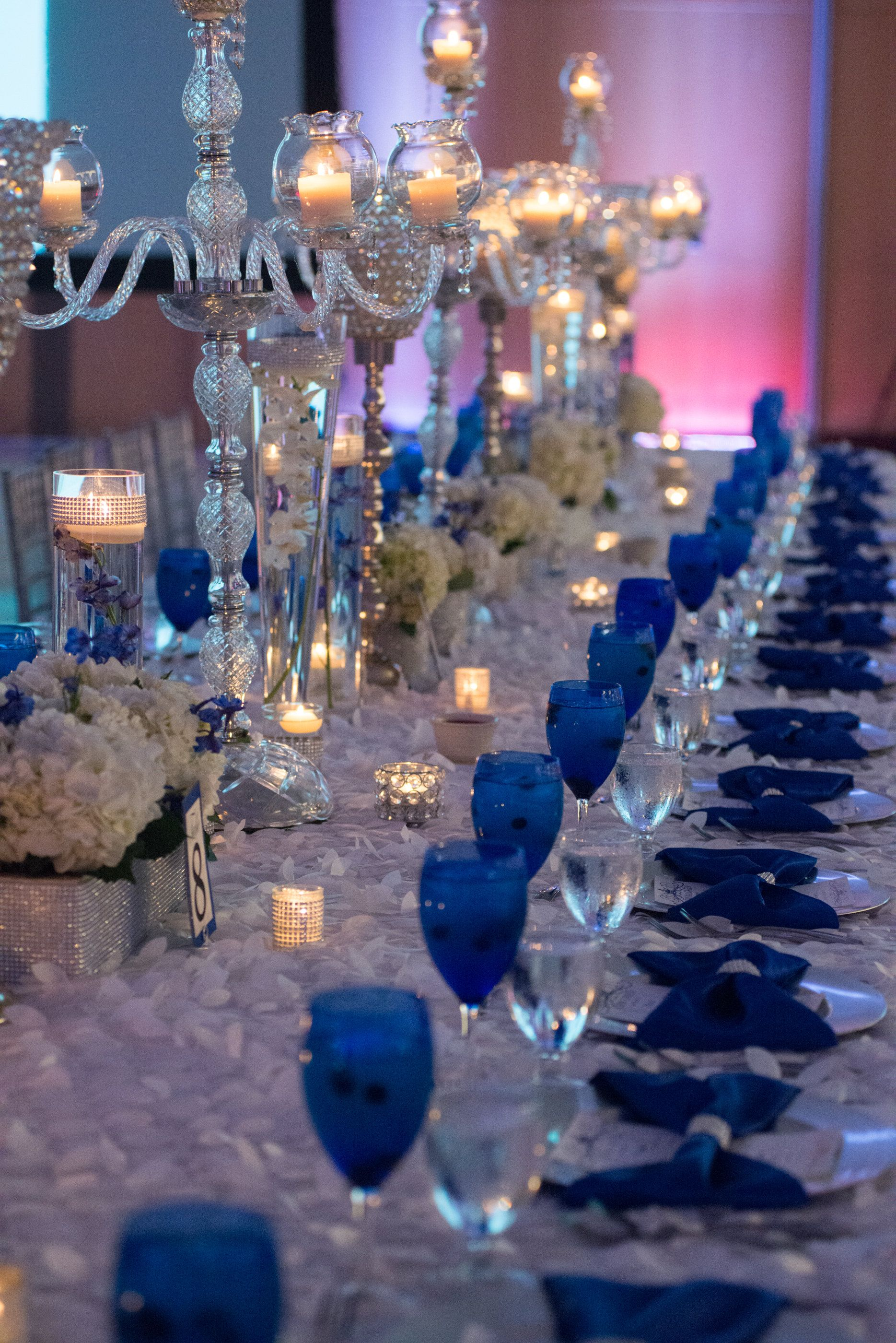 Our Royal Blue Wedding Family Styled Seating Reception Table Goblets Decor Candelabras Silver Chargers Ivory And White Petal