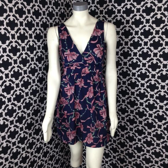 "🆕LISTING Tea N Rose Sleeveless Dress This is a sleeveless dress, has an elastic waist, tie back, v-neck. Navy blue with red and white bows ,super cute. Measures 16"" PTP, 33"" long. 100% poly. Tea N Rose Dresses Midi"