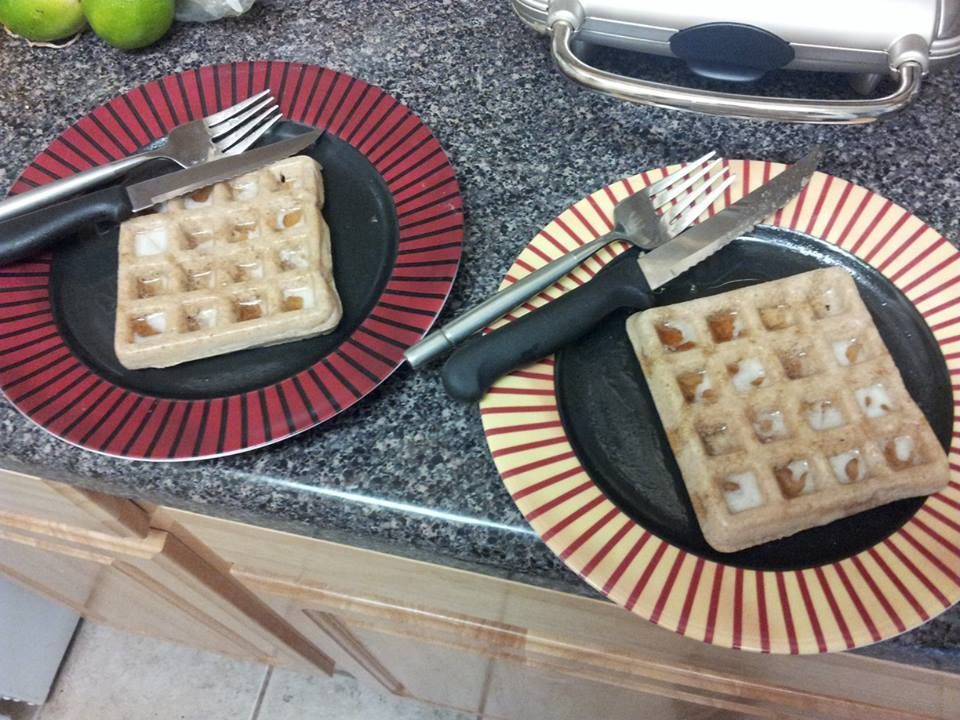 Banana cinnamon waffles with dark amber maple syrup.