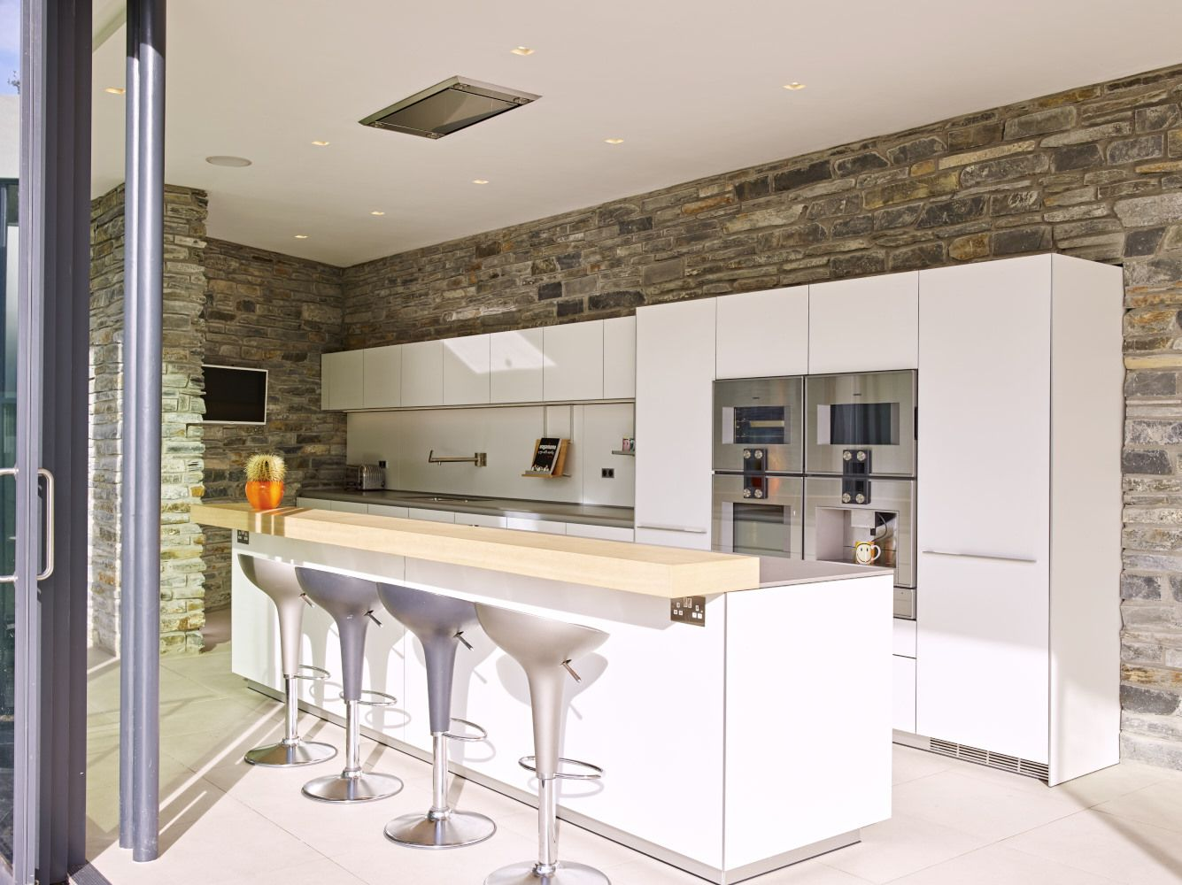 bulthaup b3 white kitchen against contrasting stone