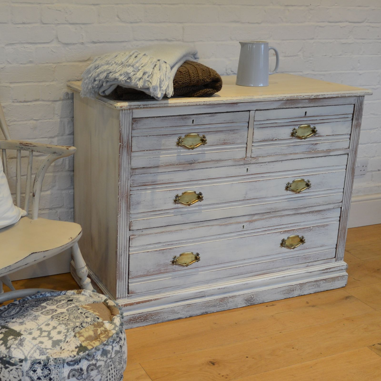 Substantial Edwardian chest of drawers painted in Annie Sloan's Original, heavily distressed and waxed. Available from Charlotte Jones Interiors.