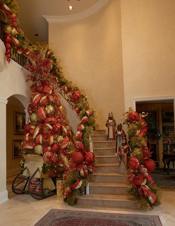 stairway decor in red and gold - How To Decorate A Staircase For Christmas With Deco Mesh