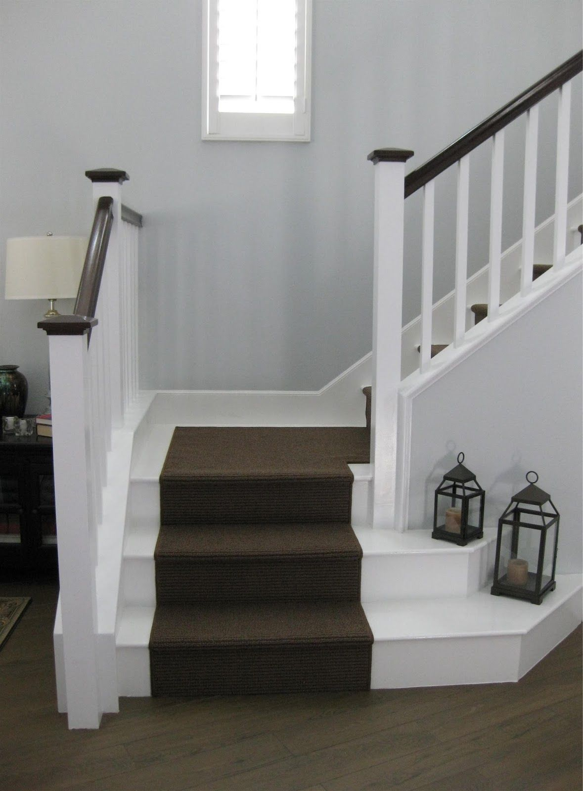 White Painted Laminate Stairs with Carpet Runner Stair
