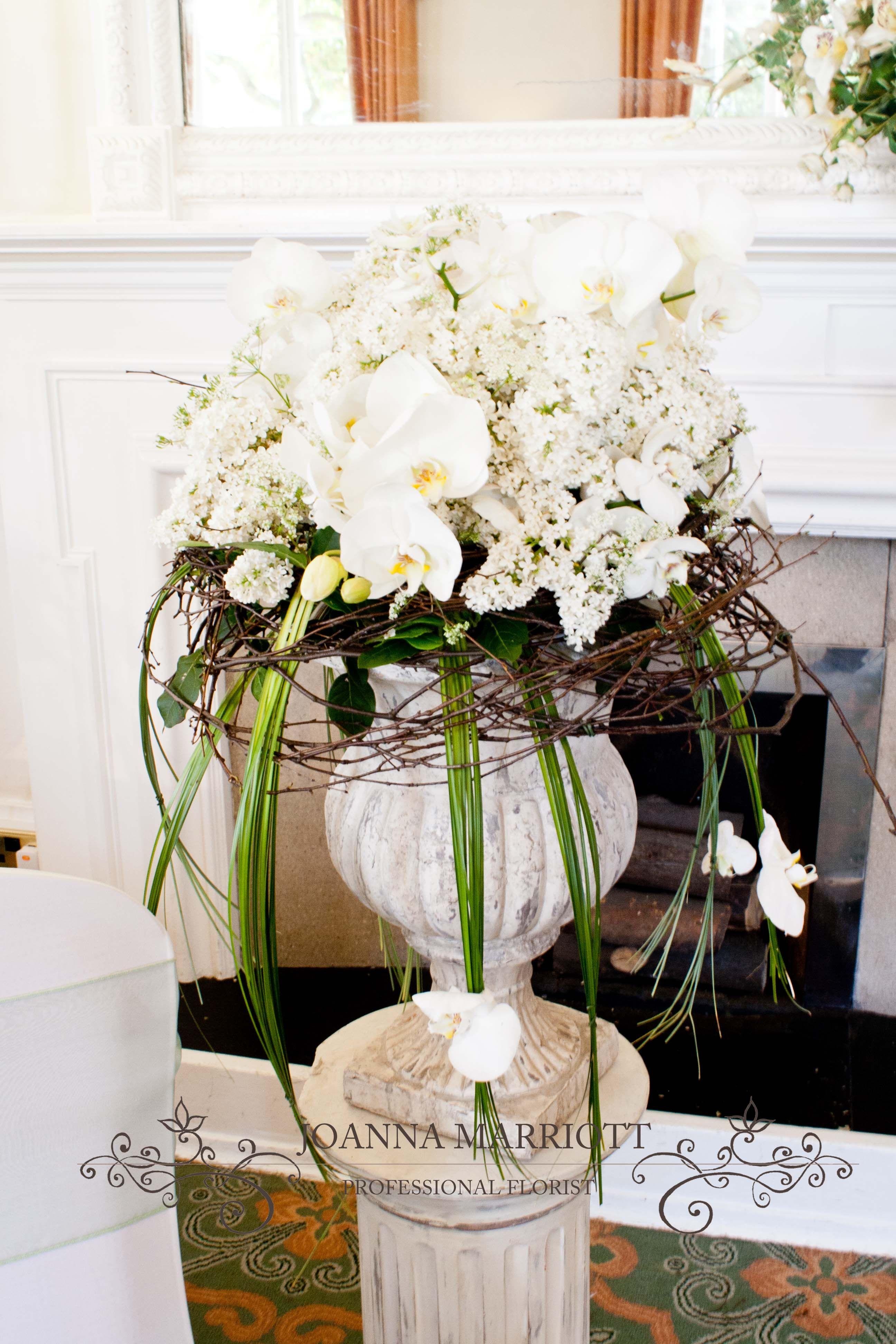 Lilac And White Orchid Pedestal Arrangement Wedding Designs