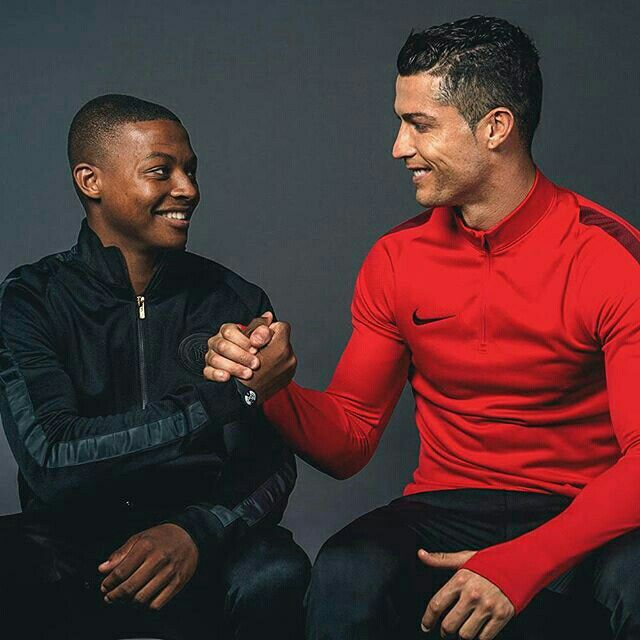 One fierce competitor meets another.  After a series of red hot performances, Nike Football App member, @d_davis_9 is presented with his new #Mercurial CR7 Savage Beauty from @cristiano. Download the app. You could be next.