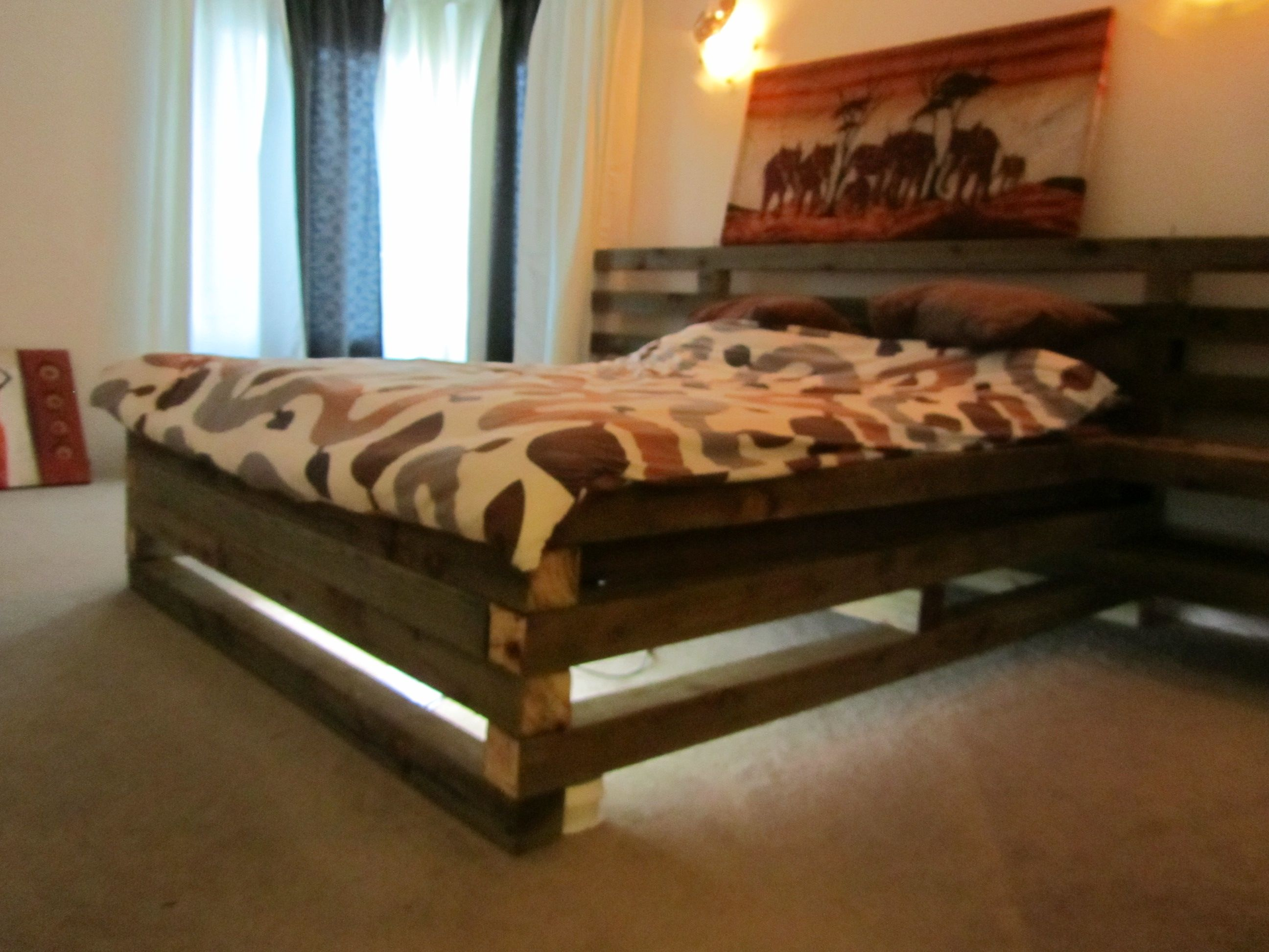Bed made from home depot logs with fluorescent