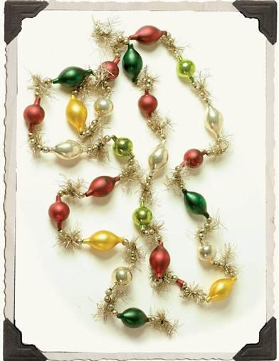 "And add several of these ""GREAT AUNTIES GARLAND"" glass bauble strands for that vintage Christmas look."