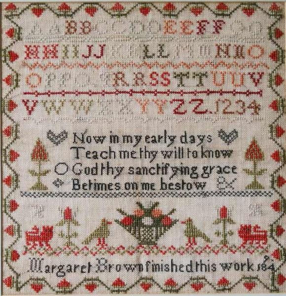 AN EARLY VICTORIAN NEEDLEWORK SAMPLER worked in polychrome threads by Margaret Brown 1849, with a row of alphabet letters, a religious verse and pictorial depictions of plants and animals, with maker's name and date below, all within a stylised foliate border, card mount and modern frame, under glass. 30.5cm x 30cm
