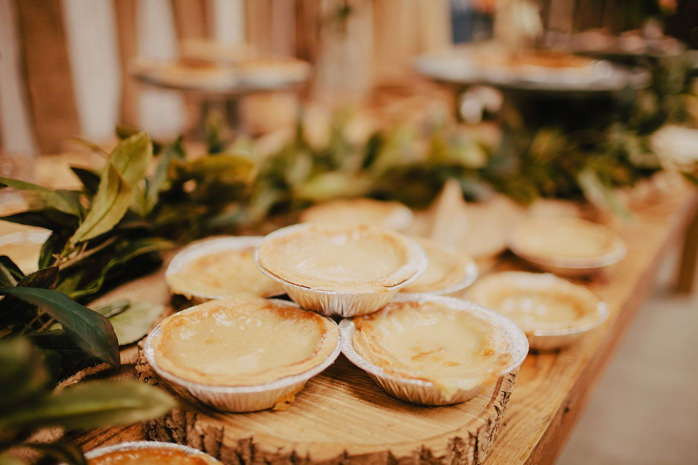 Barn wedding cake table ideas  Rustic vintage wedding dessert table pies By Luke Bugenske