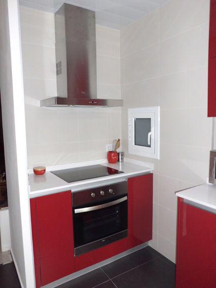 Reforma de cocina. muebles negro brillo, silestone naranja ...