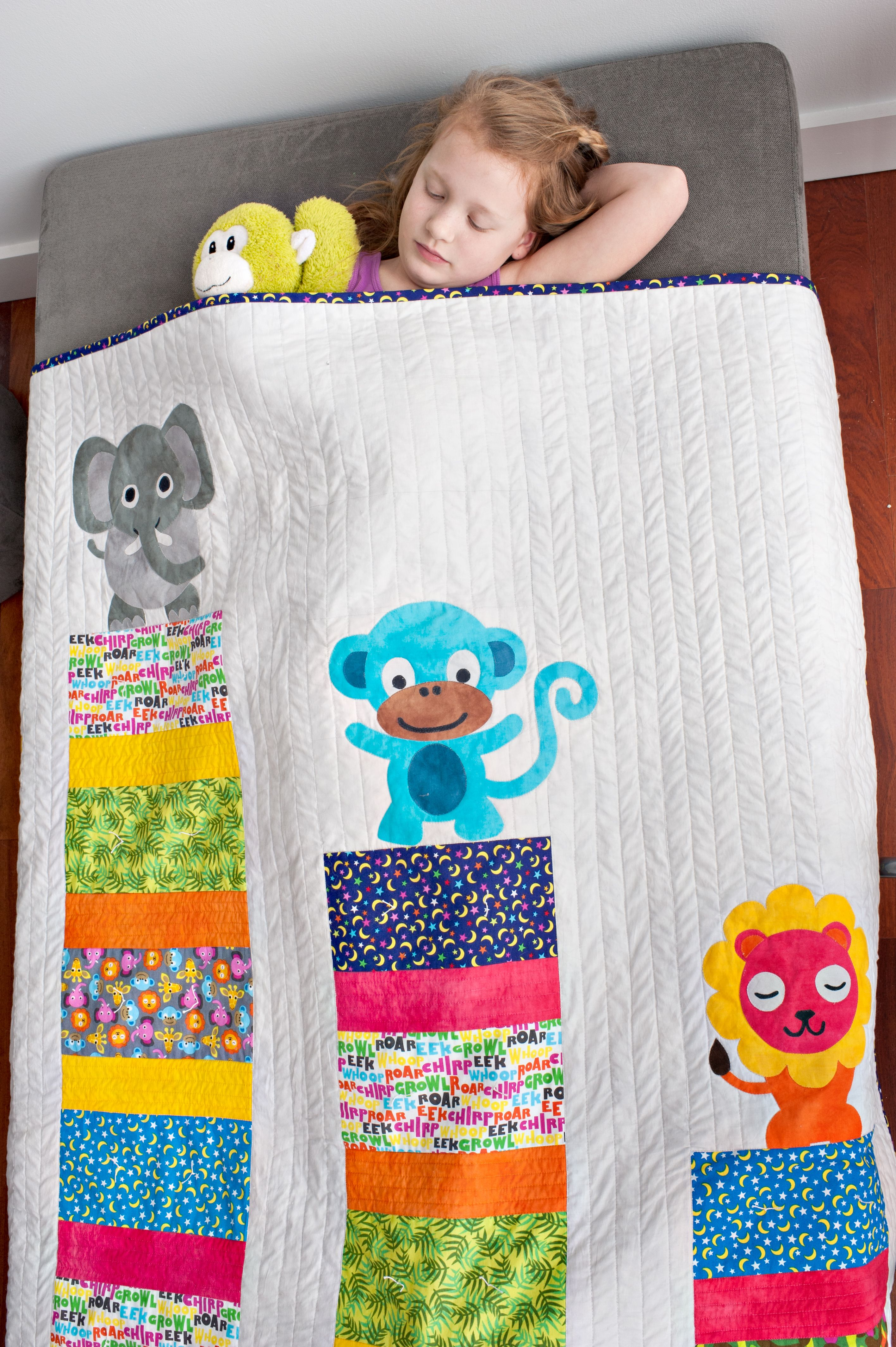 French Bull's Kids Jungle Collection for Windham Fabrics. So many cute prints, sew many possibilities - like this Elephant, Monkey and Lion quilt!