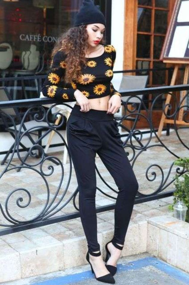8f3411a7f53c floral crop top paired with black jogger pants