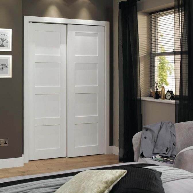 Merge The Contemporary With Traditional Styling Our Shaker Four Panel Primed Glazed Door Has Four Large Wind In 2020 4 Panel Doors Primed Doors Sliding Wardrobe Doors