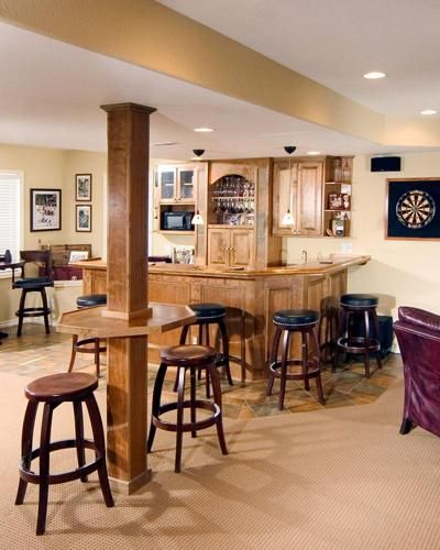 70 Home Basement Design Ideas For Men: Post With Bar Is Good Way To Cover Pipe In Basement