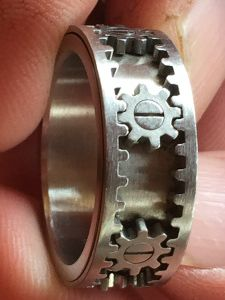 Cool rings!  Wedding Ring age 35+ Gold Silver Platinum. Under 35 Tungsten Wood Zirconium palladium stainless steel Titanium show # 177.