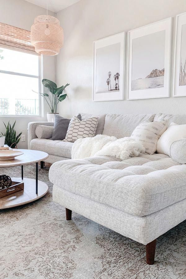 Make an all white space work by mixing in different patterns and textures. Photo by Domestic Blonde. #Sofa #MCMSofa #MidCenturyModern #modernlivingroom