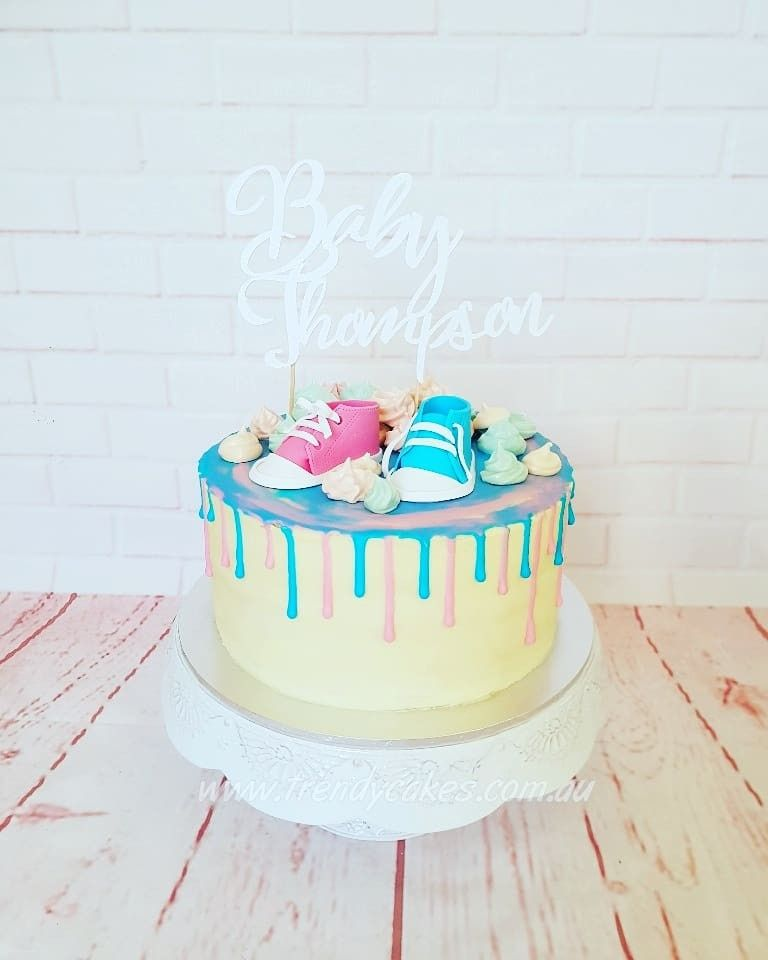 934cf5413fce Fondant converse on a gender reveal drip cake. Find this Pin and more on Baby  shower cakes ...