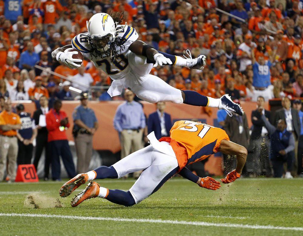 Melvin Gordon dives over Denver Broncos strong safety