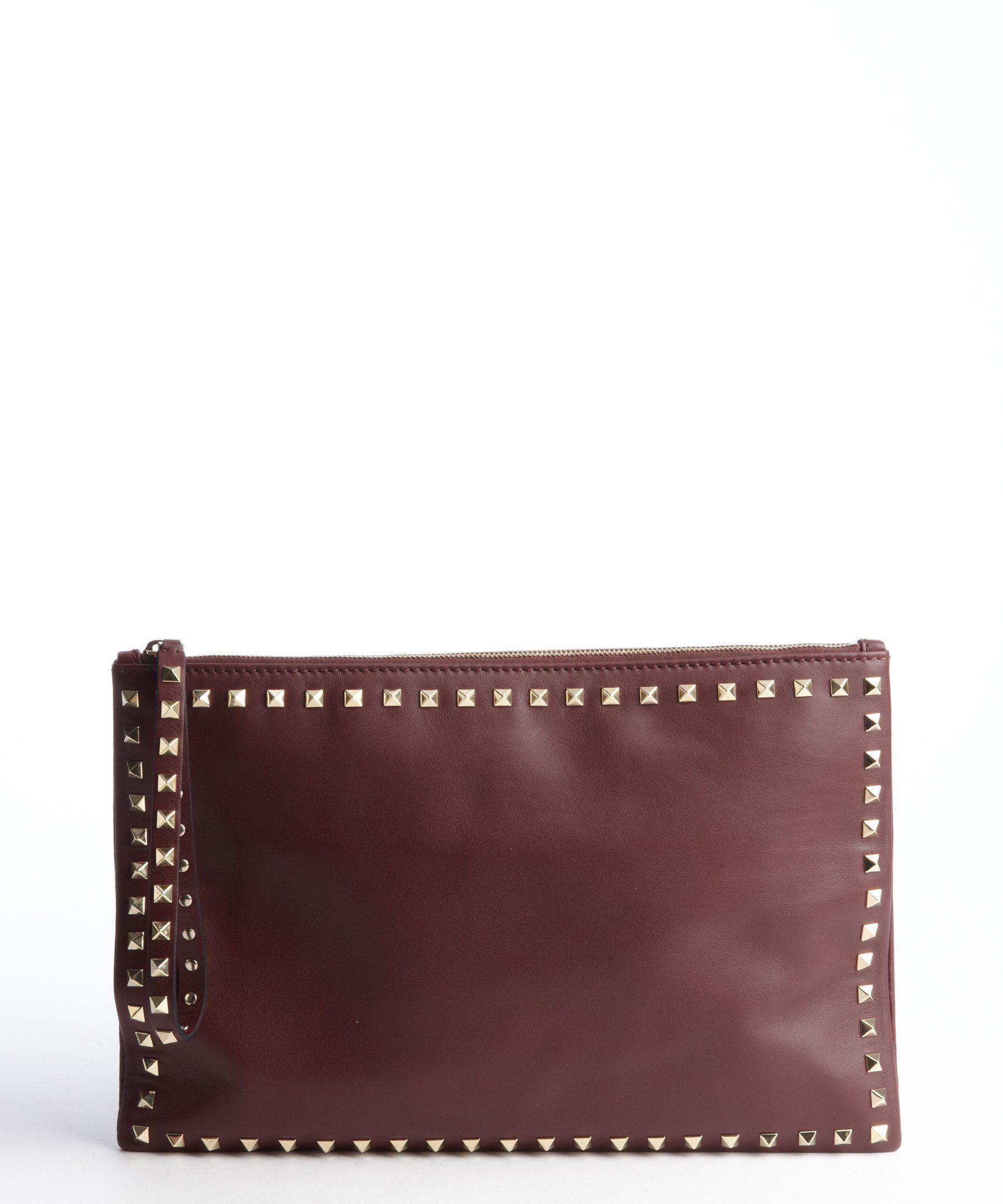 Valentino ruby leather studded large wristlet clutch | BLUEFLY up to 70% off designer brands