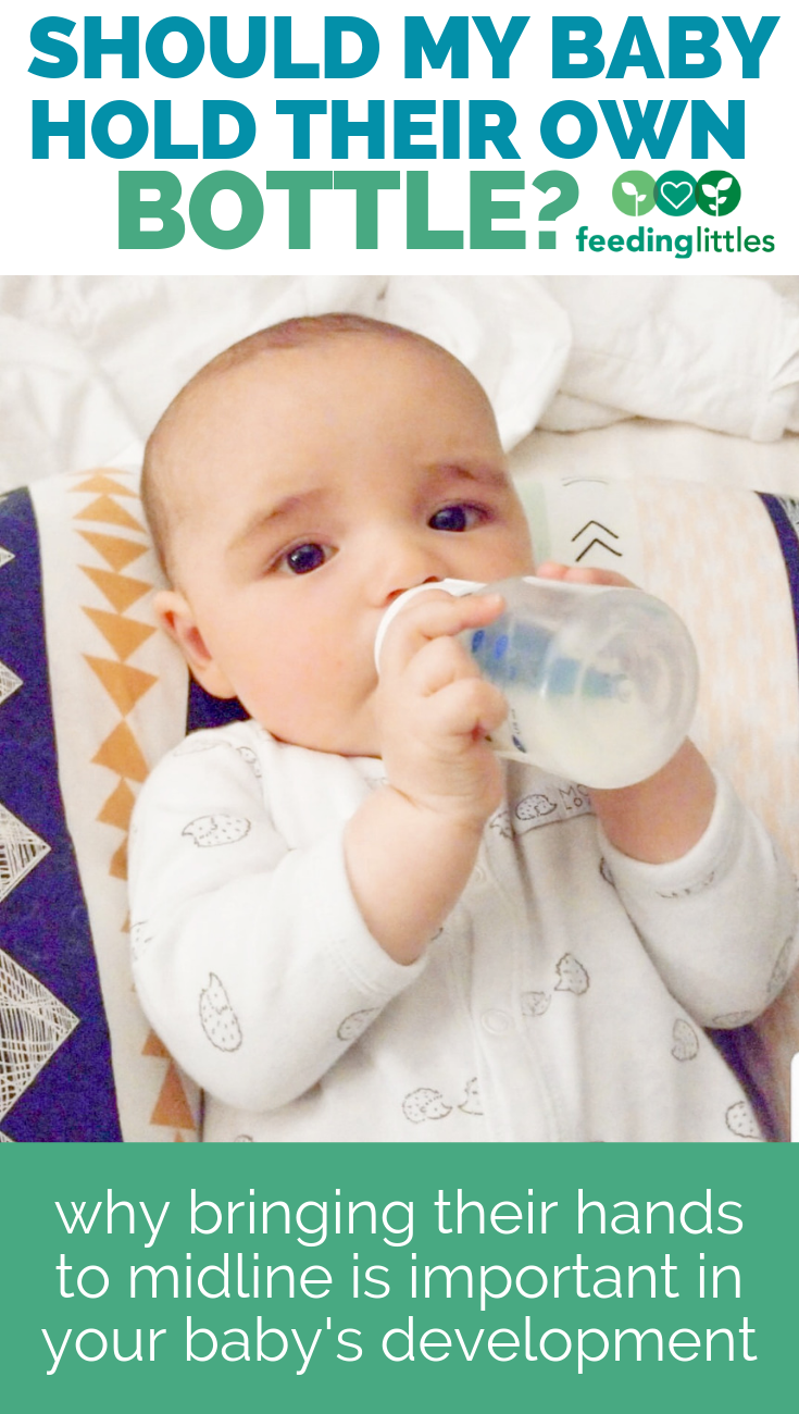 Should my baby hold their own bottle?   Baby development ...