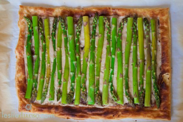 """Springtime Asparagus Tart    Recipe and Photo Courtesy of Leslie Durso, Veggie Dreamgirl Southern California native Leslie Durso runs her eponymous blog, which offers """"farm-to-stylish-table"""" recipes featuring a focus on """"whole"""" food. She has been a practicing vegetarian since the age of eight, and her work has been featured on Mother Nature Network, Glamour magazine, Maxim magazine, and many other publications. Recipe serves 8 Ingredients •   1 sheet of frozen puff pastry (or homemade) •…"""