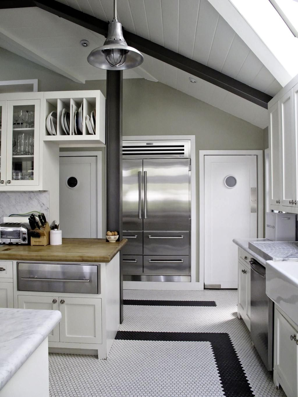 Penny Tile Floor In Kitchen With Black