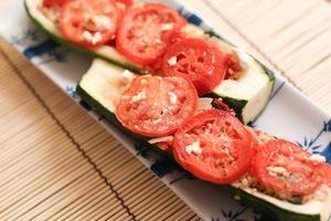 Quinoa Stuffed Zucchini with Roasted Tomatoes (add chicken & pesto instead of coconut oil)