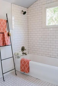 subway tiled shower with mosaic tiled flooring