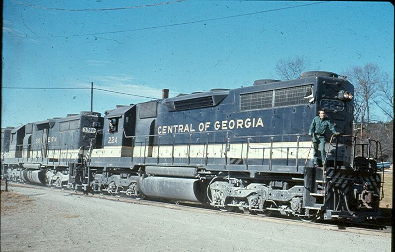 CofGA 224   Description:  Central of Georgia SD35 224 now wears Southern Ry colors works the CofGA line in Bremen.   Photo Date:  12/5/1970  Location:  Bremen, GA   Author:  Unknown  Categories:    Locomotives:  CG 224(SD35)
