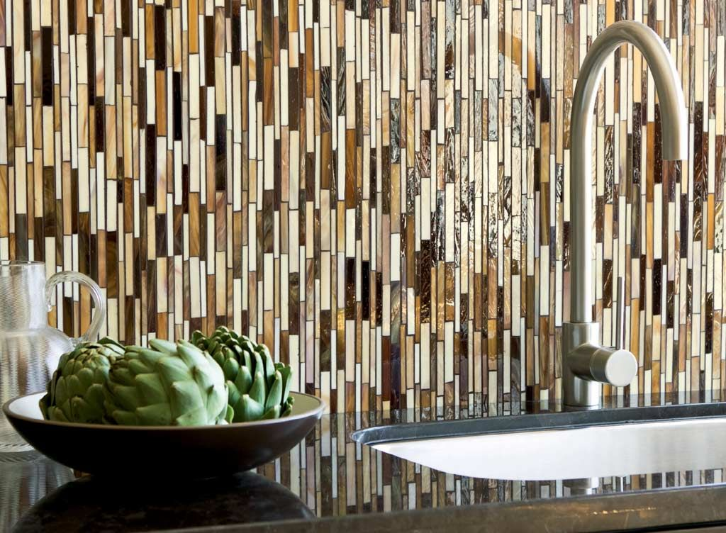 thin vertical glass tiles are on trend for contemporary kitchen backsplashes