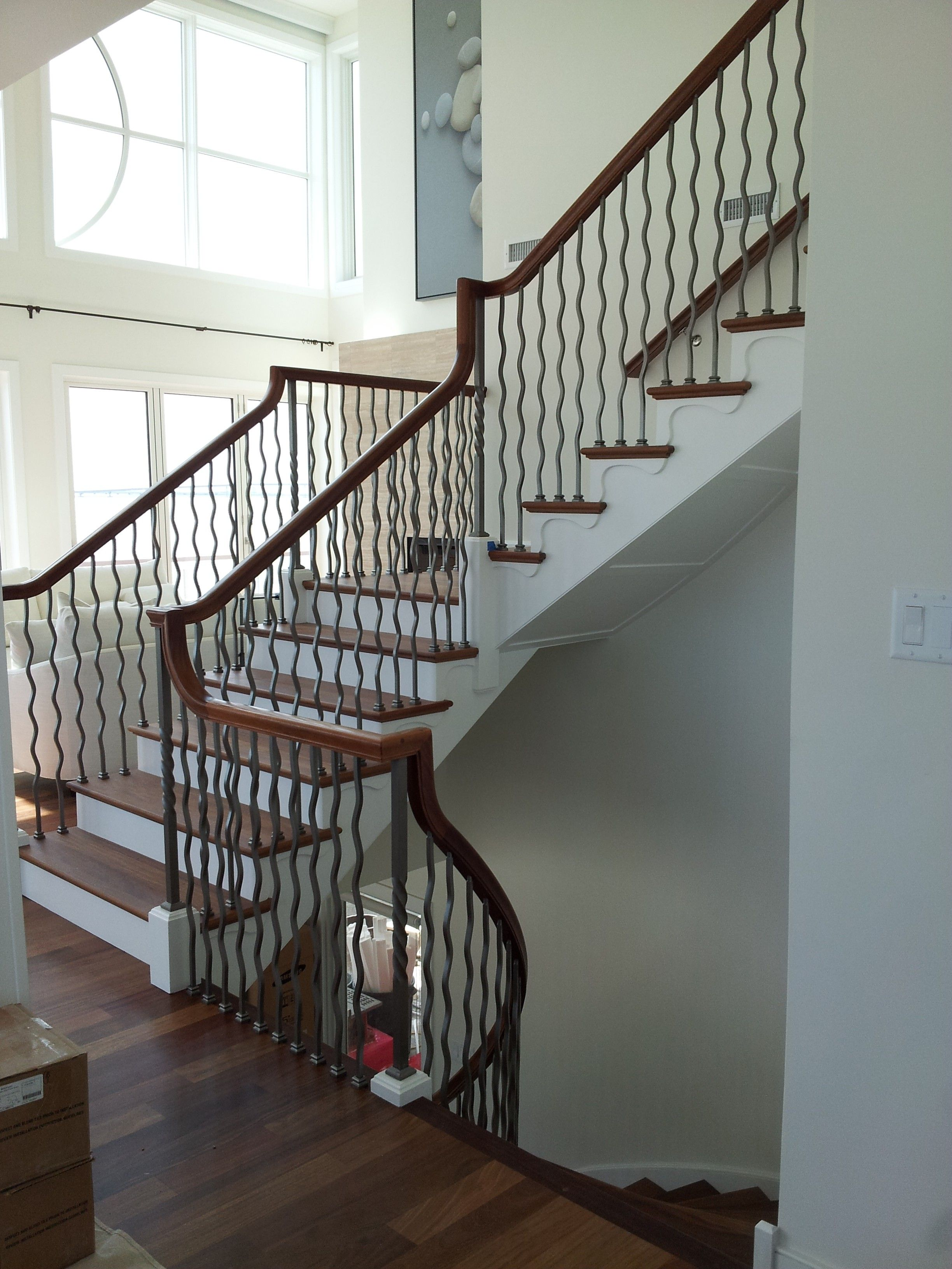 Our Wave Balusters in Warm Nickel, for the perfect rustic modern look.