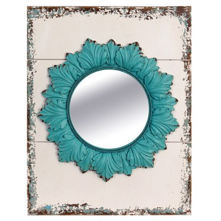 "Weathered wood wall mirror with a blue leaf-inspired frame.Product: Wall mirror    Construction Material: Wood and mirrored glass   Color: Turquoise and cream       Dimensions: 16"" H x 13"" W x 1"" D"