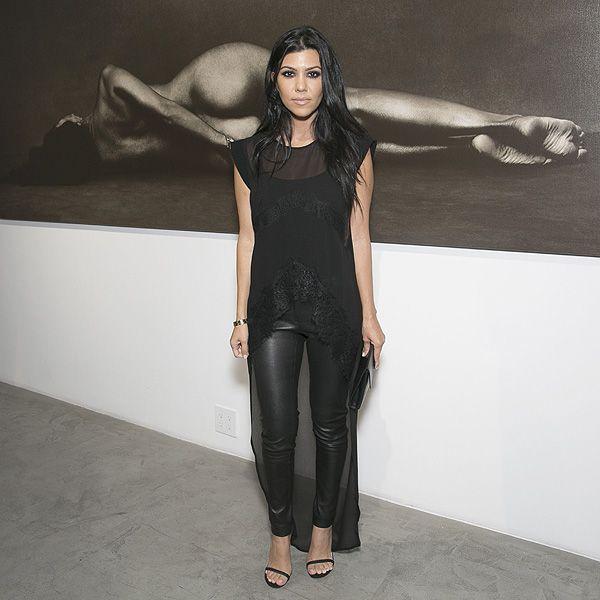 Kourtney Kardashian Poses Next to Her Glamorous Nude Photo
