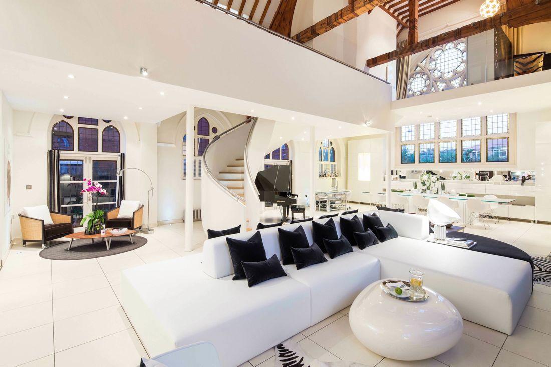 Architectural bureau gianna camilotti interiors converted a historic church into a massive contemporary home in london uk