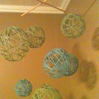 Yarn ball mobile over the changing table.