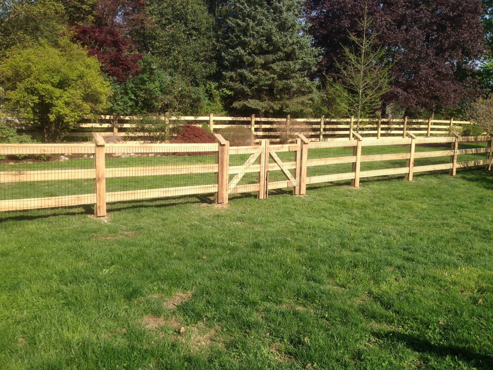 Rough Sawn Wood 4 Rail Fence Stained Black With Attached Wire Fence Backyard Fences Fence Landscaping Farm Fence