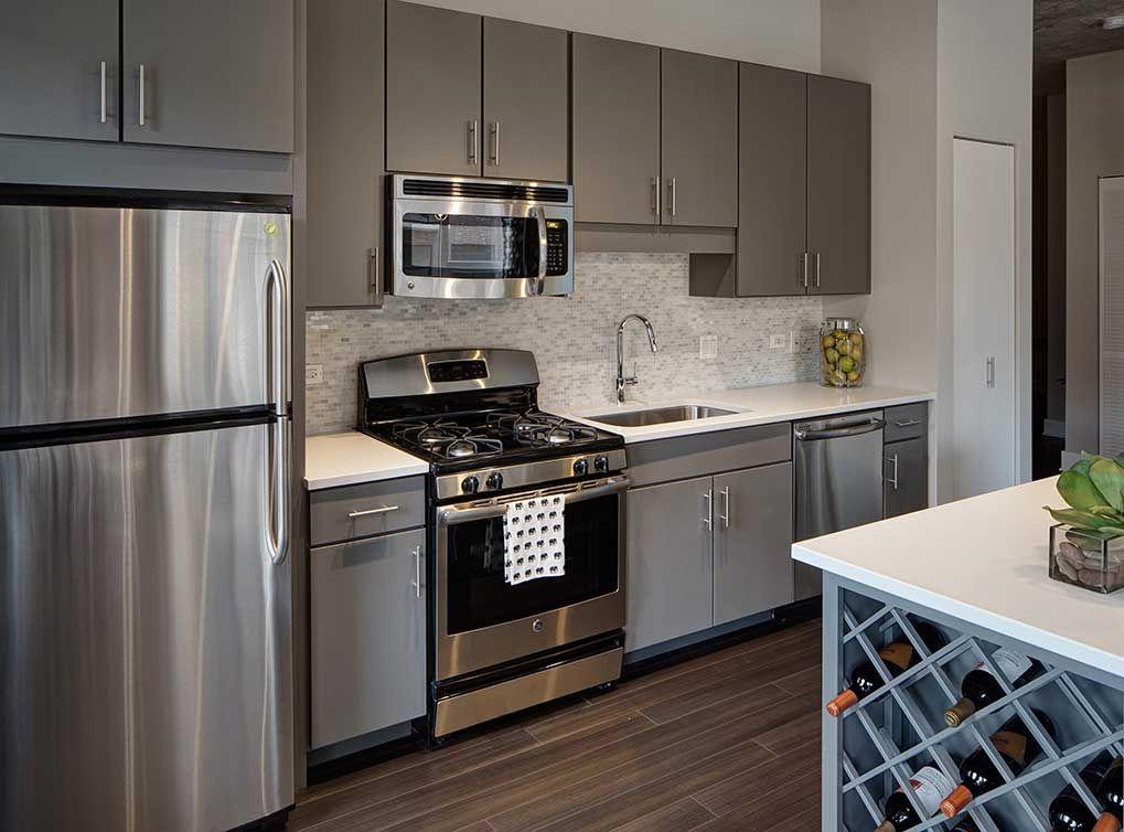 Modern Kitchen With Hardwood Floors Stainless Steel Appliances White Quartz Countertops Grey Kitchen Design Hardwood Floors In Kitchen Contemporary Kitchen