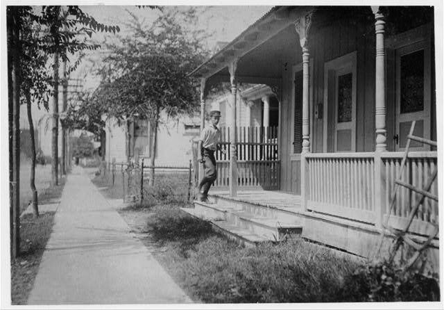 "TEXAS WHOREHOUSE: Sixteen year old messenger boy entering ""crib"" in Red Light district. Location: San Antonio, Texas"