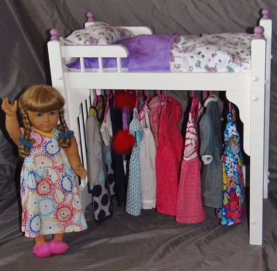 American Girl Doll bed and clothes storage unit combo with dancing Fairy bedding and ladder is part of Dance Clothes Storage - 2  Our bedding is all handmade in a smoke free environment, using only high quality fabric and thread   All mattresses and pillows are filled with 100% premium polyester fiber fill  FINISH The finish starts with carefully hand sanding all our doll furniture and then applying two coats of water based primer, sanded in between coats   Then two coats of water based antique white semigloss paint are applied   No harmful chemicals are used in any of our finishes  Please email with any questions  APPROX BED DIMS  22 L x 12 5 W x 23 H  Please allow 23 weeks for delivery  PLEASE CONTACT US FOR INTERNATIONAL SHIPPING QUOTE  NONMAINLAND STATES, PLEASE CONTACT US FOR SHIPPING QUOTE  ALL ITEMS ARE SHIPPED USPS, FULLY INSURED WITH DELIVERY CONFIRMATION  DOLL AND DOLL CLOTHES NOT INCLUDED  Thank you for taking the time to view our listing and don't forget to check out our shop   We have several other items that fit the American Girl Doll, bunk beds, table and chair sets, armoires, single beds, fine heirloom quality furniture, computer monitors stands, spice cabinets, primitive items and more   Stop back often, as we are always adding new items  Thank you, Sharon and Ed Keating Woodcraft