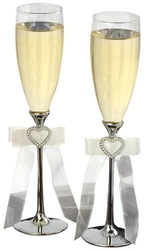 $36.85-$50.00 Make your first toast as husband and wife one to remember with these Toasting Flutes. Complement your head table with beautiful toasting flutes sure to capture everlasting moments in photographs for years to come. A beautiful wedding can start from the smallest detail or ideas, which then turns into a mood or theme that represents you. Our collections make your wedding come alive w ...