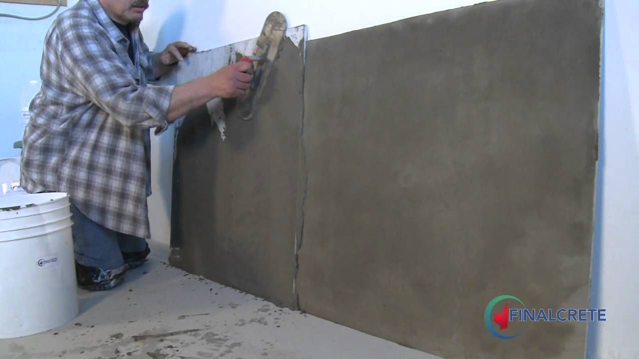 Covering The Cinder Block Wall With Gray Parging