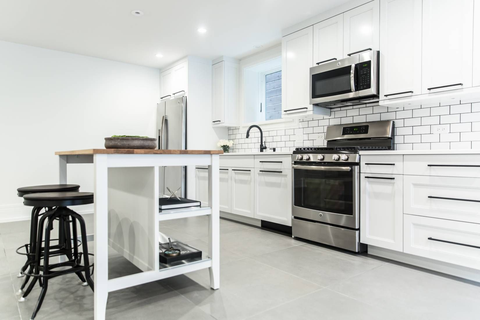 White Vintage Kitchen In A Chicago Apartment With Subway Tile