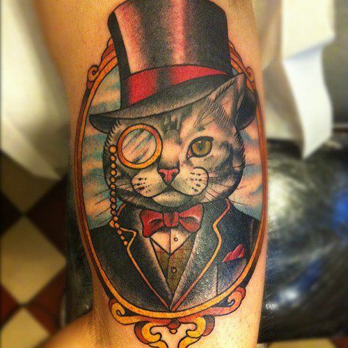 11 of the most hilarious and goofy cat tattoos for the cat lover in all of us (don't try to hide it, we know who you are!) | INKEDD