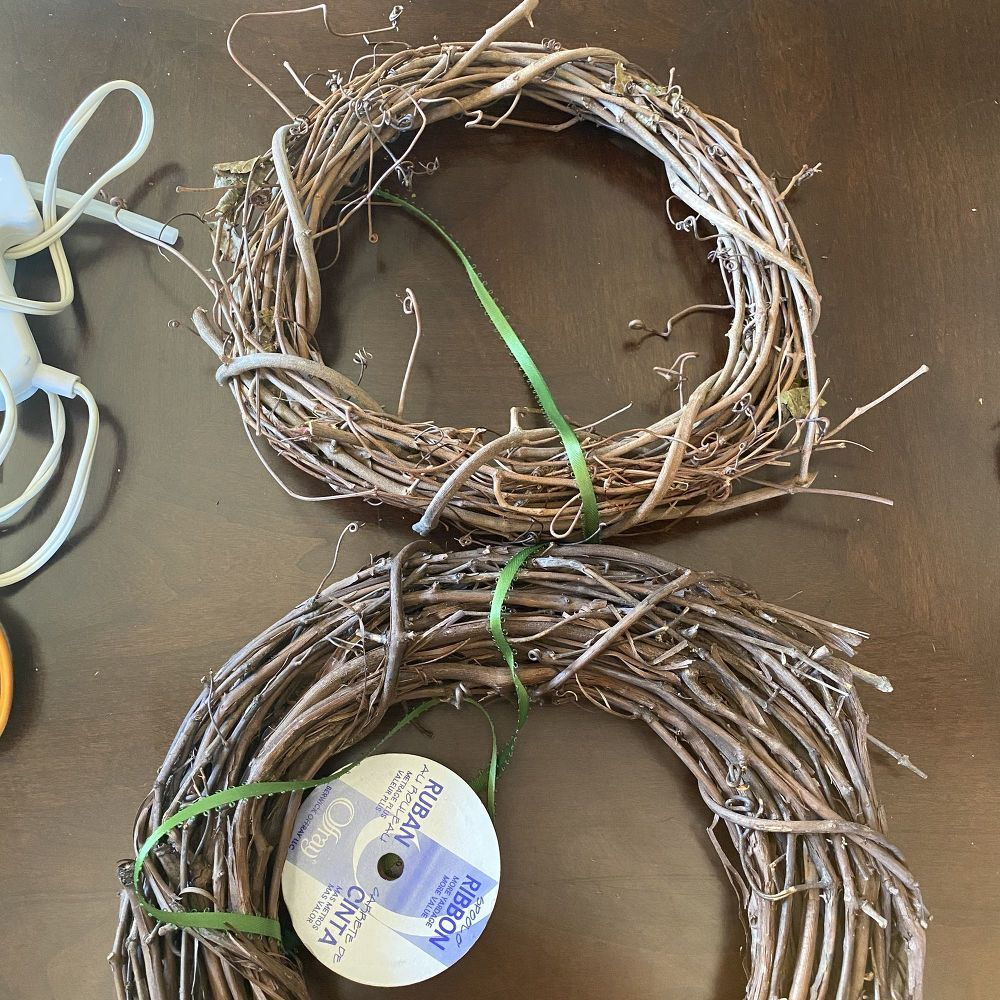 How to Make an Easter Bunny Wreath DIY - Easter bunny wreath diy, Bunny wreath diy, Easter bunny wreath, Bunny wreath, Cute easter bunny, Inexpensive wreaths - Make this cute Easter bunny wreath for less than $25  Customize it with any color you want as spring approaches  Gather Supplies Needed Ashland Bush Gerbe 3 Bundles $3 99 40% off eachAsland 10  Wreath x2 $4 99Ashland 12  Heart Wreath $7 99Ribbon, scissors, cupcake holders, glue gun household items Connect Wreaths Use your ribbon to tie the two wreaths together  I chose green to match the Bush Gerbe but brown would look great too  The wreath with less twine (appears smaller) s…