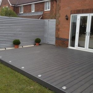 Composite decking appleton warrington deck lighting for Garden decking and grass ideas