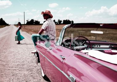 Young Woman and Man Sitting Roadside with Broken Car Royalty Free Stock Photo