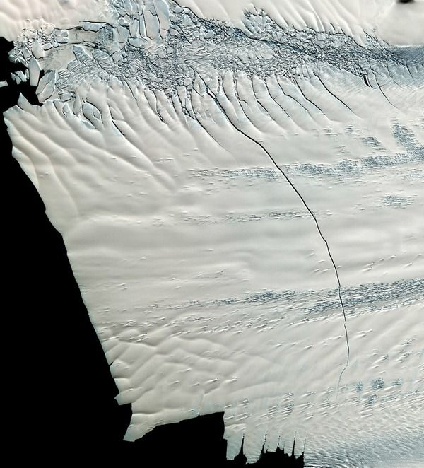 The Making of an Iceberg: .A massive crack in an Antarctic ice sheet, discovered in October 2011, was caught by a satellite in November 2011 and had grown an astounding mile in length in just about a month.  Pine Island Glacier has been producing large icebergs about every decade but researchers are surprised at the speed at which this one is forming.  Credit: NASA/GSFC/METI/ERSDAC/JAROS, and U.S./Japan ASTER Science Team