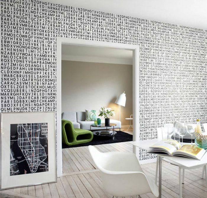 wohnzimmer einrichten weiss schwarz muster typo Wandgestaltung